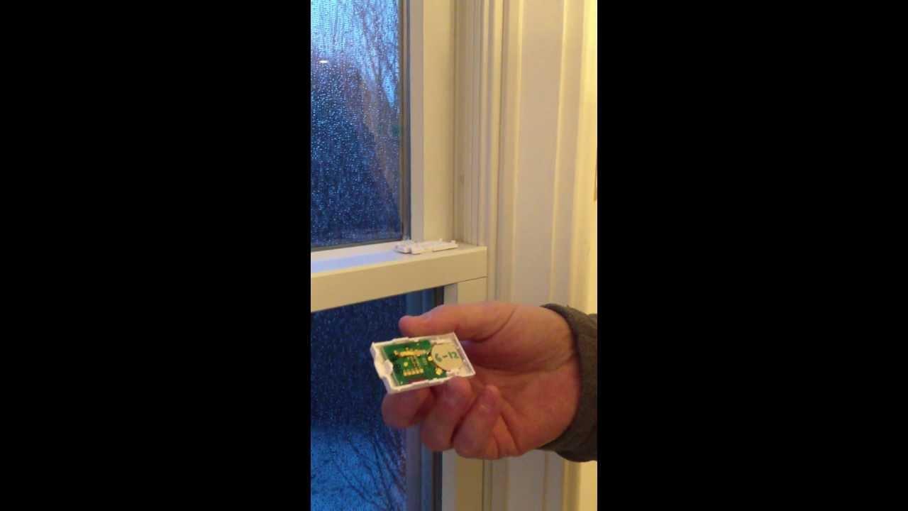 how to change the battery on a honeywell 5811 window sensor [ 1280 x 720 Pixel ]