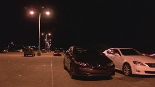 UNM students push for extra lighting, security at parking lot