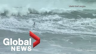 World's top surfers brave 50+ foot waves in Portugal's Praia do Norte