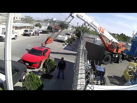 Hanging Crane Narrowly Misses Car Parked In Harbour