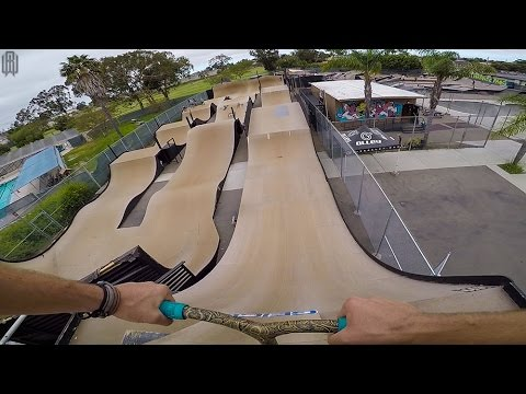 SCOOTER TRICKS ON GIANT SKATEPARK RACETRACK!