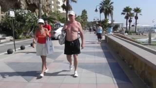 SLOW WALKING ALONG THE BEACH FROM BENALMADENA TO TORREMOLINOS, SPAIN