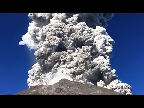 Volcano erupts as campers cook breakfast at the foot of Mount Merapi