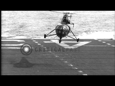 An US Navy H-5 (HO3S) helicopter lands on the deck of USS Valley Forge (CV-45) in...HD Stock Footage