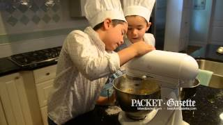 The Cookie Brothers -- with the assistance of their mother, Nicole -- get busy with another batch they make for donation and to help raise money for charities.