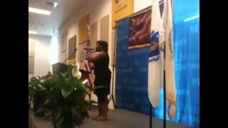 Student sings at UMass Dartmouth MLK breakfast