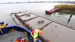 Angus Armstrong, Harbour Master at Ports of Toronto, takes us on board the Iron Guppy as it takes a containment cell on the spit at Tommy Thomson Park, towing a drop bottom scow filled with material dredged from the bottom of the Don Valley River.