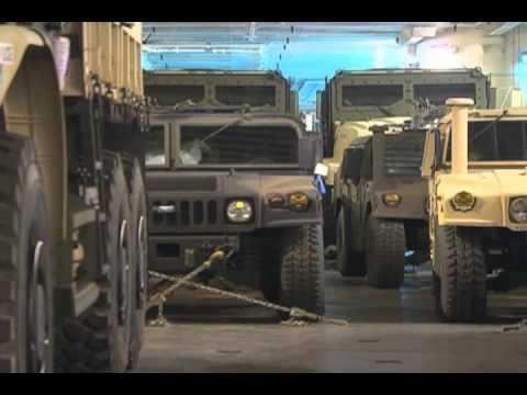 Honeywell contractors repair USMC vehicles, Blount Island, Florida