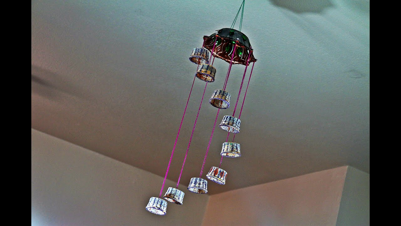 Recycled wind chime craft made out of plastic cups youtube for Decorative items for home with waste material