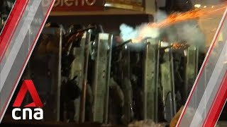Police fire tear gas as citywide strike paralyses Hong Kong