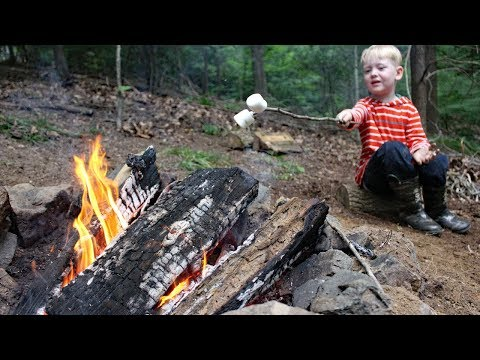 How to build a fire!! Best fire starter, fire safety & a one-match campfire in the rain