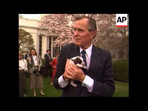 President George H.W. Bush and his wife Barbara show off First dog Millie