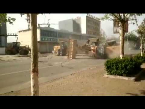 """""""War of Loaders"""" on the street of Chinese town"""