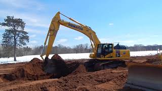Video still for Road Machinery & Supplies of Savage Minn. Shows Off Komatsu PC360LC at New Iron Expo
