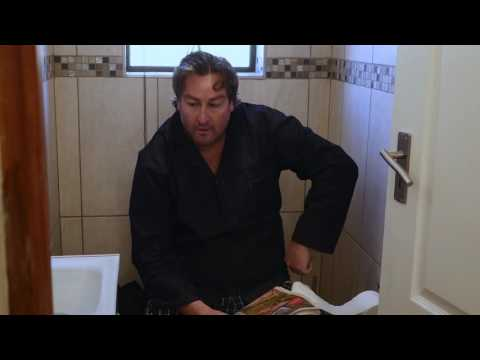 Plumber - Doing business on the toilet