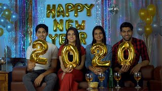 Indian boys and girls celebrating New Year Eve in a decorated room at home in India