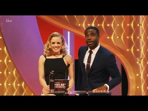 Joanne Clifton and Ore Oduba presenting a British Soap Award to Emmerdale