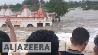 India floods: Monsoon rains kill at least 16