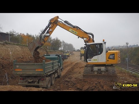 Liebherr A918 Excavator Digging Rock And Loading Tatra Truck