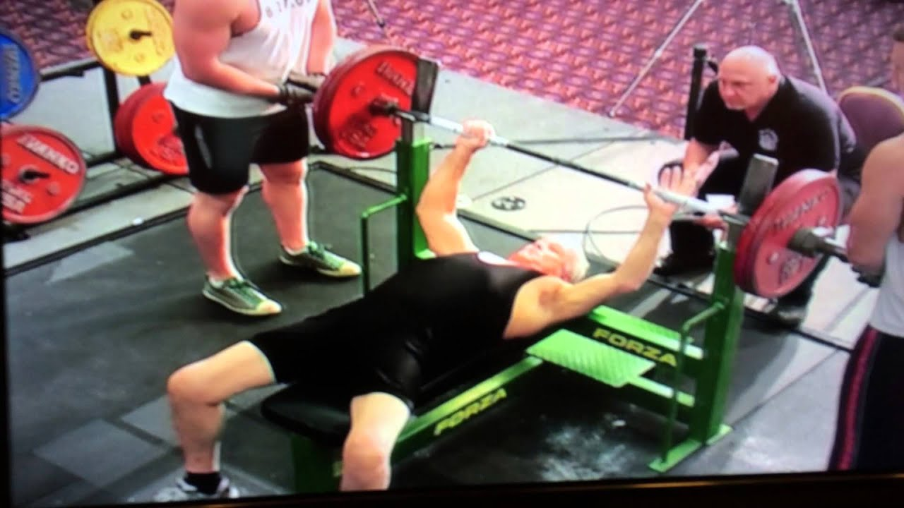 80 year old sets bench press world record