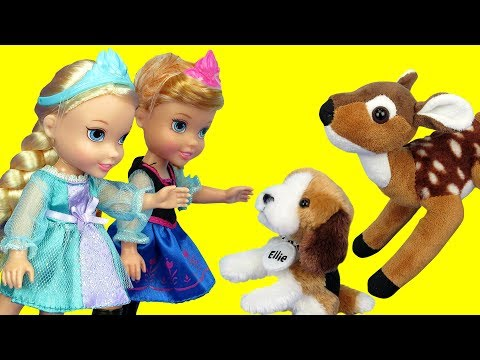 Elsa and Anna toddlers feed cute stuffed animal pets