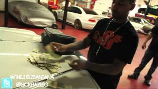 Juelz Santana Shows His Car Garage & Smokes Blunt