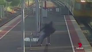 *VIEWER DISCRETION ADVISED* Man Tries To Throw Girlfriend In Front Of Oncoming Train