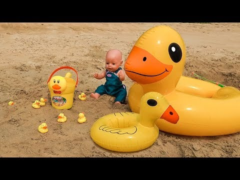 Kid and Doll and Toys from sand on the Beach with Five Little Ducks song