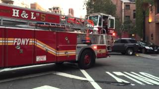 FDNY TILLER 5 RETURNING TO QUARTERS ON 6TH AVE. IN WEST VILLAGE AREA OF MANHATTAN IN NEW YORK CITY.
