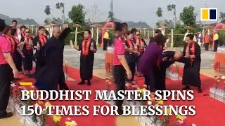 To bless Taiwan, Buddhist master spins 150 times