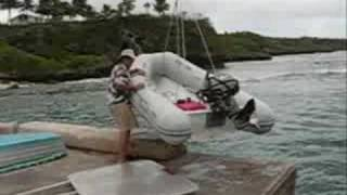 Launching from the Dinghy Dock in Niue in 20 knots of wind