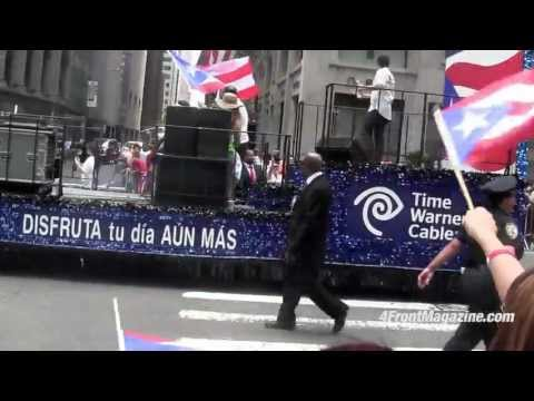 Puerto Rican Day Parade Giant's Victor Cruz dances with cop
