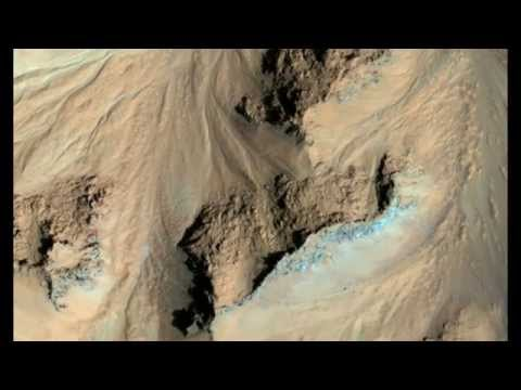 Glacial Belts of Water Ice Found on Mars. Mountain On Mars Is Leaking
