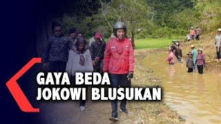 Gaya Beda Jokowi Blusukan ke Pelosok Daerah: Pakai Helm dan Kalung