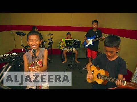 Teaching music to kids in Bangkok's slums