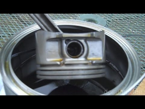 Dissolving carbon buildup from pistons - Cleaning piston ring grooves engine rebuild compression