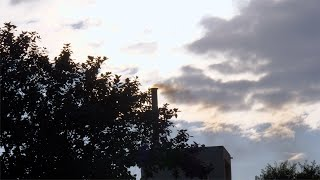 Factory chimney smoking heavy smoke in the cloudy sky - air pollution concept
