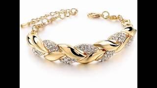 видео Жесткие золотые браслеты женские фото и цена