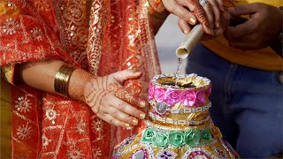 Closeup shot of Ghara Gharoli ceremony taking place at an Indian wedding