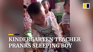 Kindergarten teacher pranks sleeping boy in class