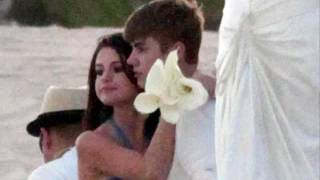 Here is selena & justin in mexico. rumors has it they are engaged, however there for a friends private wedding.