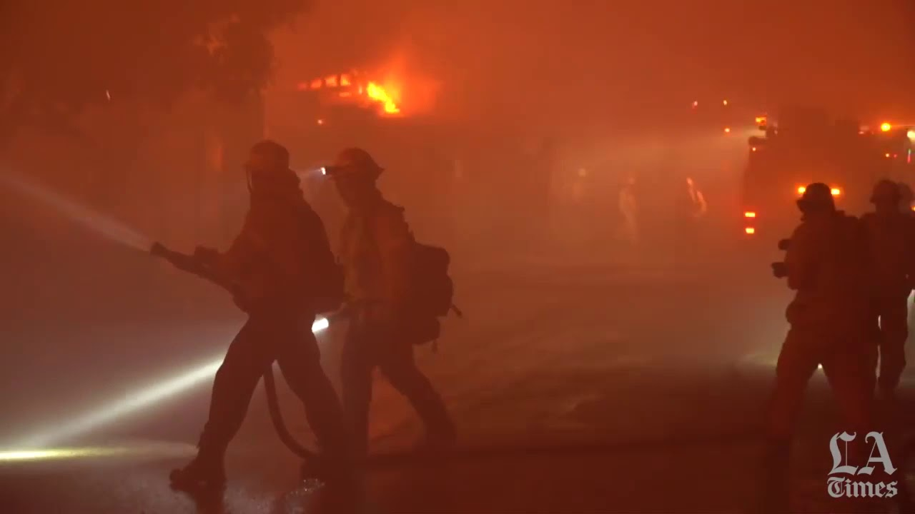 Getty fire off 405 Freeway destroys homes; thousands flee