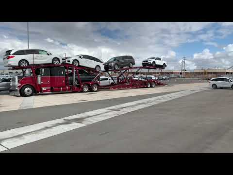 Unloading A Car Hauler Cx09