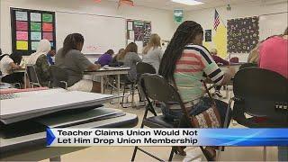 Teacher claims union would not let him drop union membership