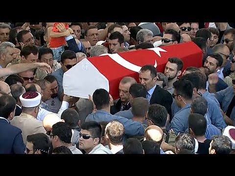 Recep Tayyip Erdogan helps carry coffin of Turkey coup victim