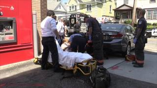 Elderly woman runs herself over with her own car.