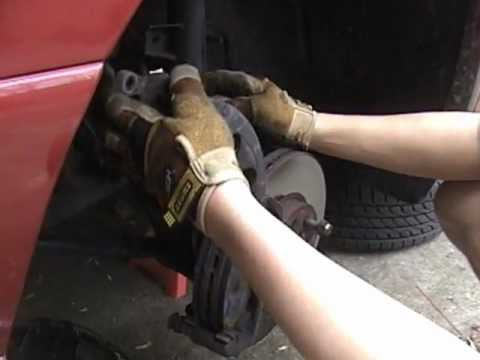 How To Inspect And Replace Front Disc Brake Pads On A Ford