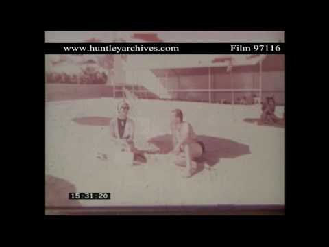 Sailing in Kuwait.  Man and woman sit on beach.  Archive film 97116