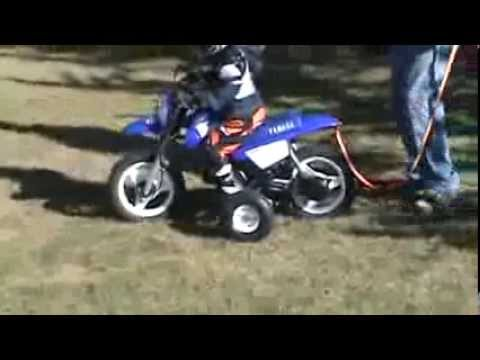 Nicholas first ride Yamaha PW50 throttle limited with Training Wheels