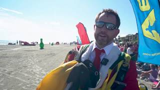 Santas fly in at  Cocoa Beach: Air Sports Parachute Team